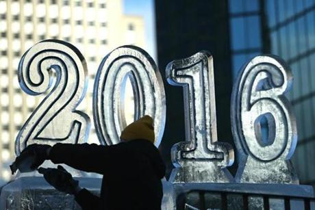 An ice sculptor put the finishing touches on a 2016 ice sculpture.
